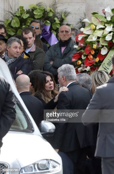 Alba Parietti embraces Fabio Frizzi at the Fabrizio Frizzi funeral service at Piazza del Popolo on March 28 2018 in Rome Italy