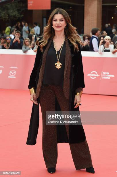 Alba Parietti walks the red carpet ahead of the 'Detective Per Caso' screening during the 13th Rome Film Fest at Auditorium Parco Della Musica on...