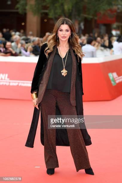 Alba Parietti walks the red carpet ahead of the 'Sono Gassman Vittorio Re Della Commedia' screening during the 13th Rome Film Fest at Auditorium...