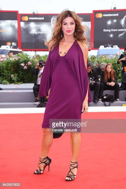 Alba Parietti walks the red carpet ahead of the 'Una Famiglia' screening during the 74th Venice Film Festival at Sala Grande on September 4 2017 in...