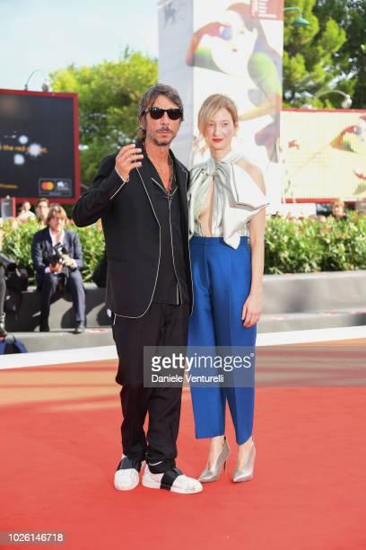 Alba Rohrwacher and Pierpaolo Piccioli walk the red carpet ahead of the 'My Brilliant Friend ' screening during the 75th Venice Film Festival at Sala...
