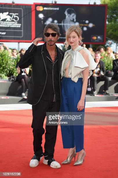 Alba Rohrwacher and Pierpaolo Piccioli walk the red carpet ahead of the 'My Brilliant Friend ' screening during the 75th Venice Film Festival at Sala...