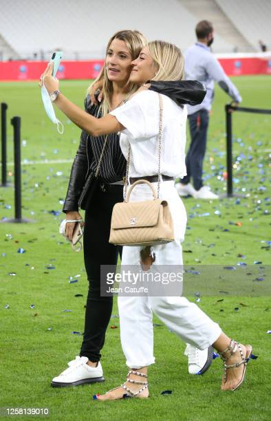 Alba Silva wife of goalkeeper of PSG Sergio Rico takes a selfie with Jorgelina Cardoso wife of Angel Di Maria of PSG to celebrate the victory...