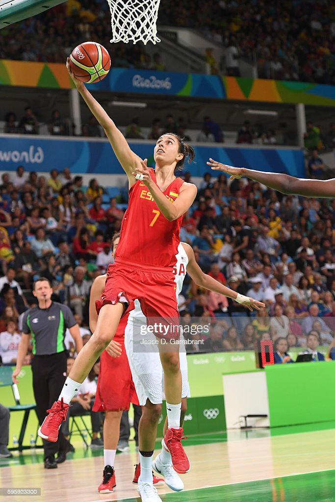 Alba Torrens of Spain drives to the basket against the USA