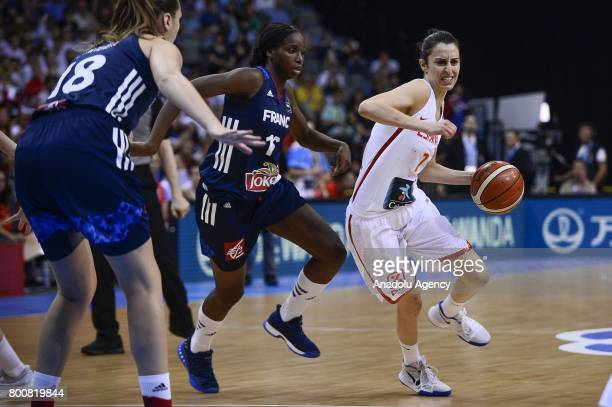 Alba Torrens of Spain in action against Endene Miyem and Alexia Chartereau of France during the 2017 FIBA EuroBasket Women gold medal match between...