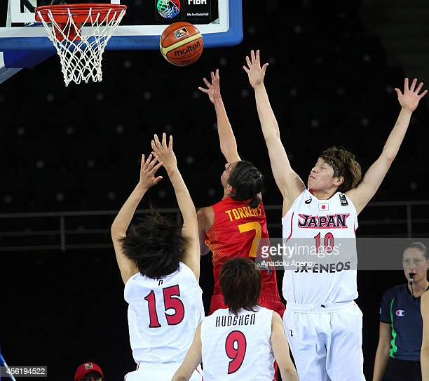 Alba Torrens of Spain in action against Ramu Tokashiki Asako O and Emi Kudeken of Japan during the 2014 FIBA World Championship For Women Group A...