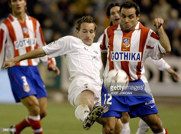 Albacete's Ivan Diaz vies with Atletico Madrid's Barjuan Sergi during a Premier league match in Carlos Belmonte stadium in Albacete 24 January 2003