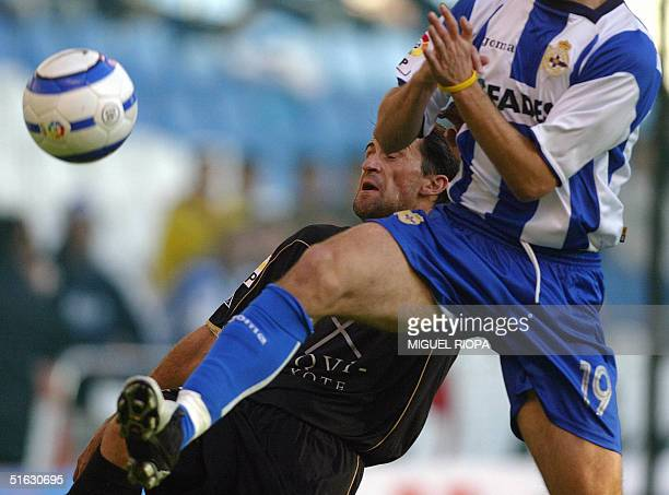 Albacete's player Oscar Montiel tries to control the ball next to Deportivo Coruna's Albert Luque during the Spanish first league football match at...