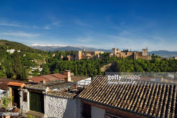 Albaicin restaurant at Saint Nicholas lookout with Generalife Alhambra fortress and Sierra Nevada Mountains Granada
