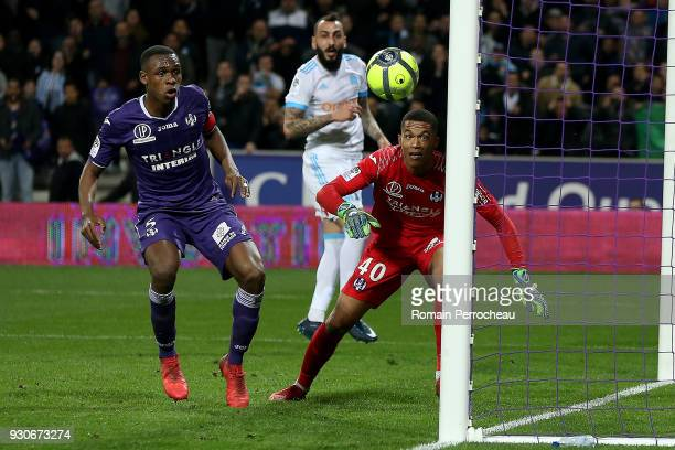 Alban Lafont and Issa Diop of Toulouse look on during the Ligue 1 match between Toulouse and Olympique Marseille at Stadium Municipal on March 11...