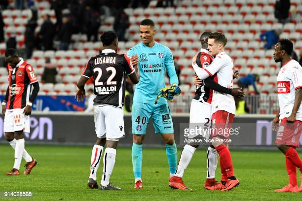 Alban Lafont and Players of Toulouse celebrate at the end of the game during the Ligue 1 match between OGC Nice and Toulouse at Allianz Riviera on...