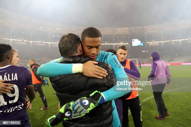 Alban Lafont of Toulouse celebrates with Head coach Michael Debeve during the Ligue 1 playoff match between Toulouse and AC Ajaccio on May 27 2018 in...