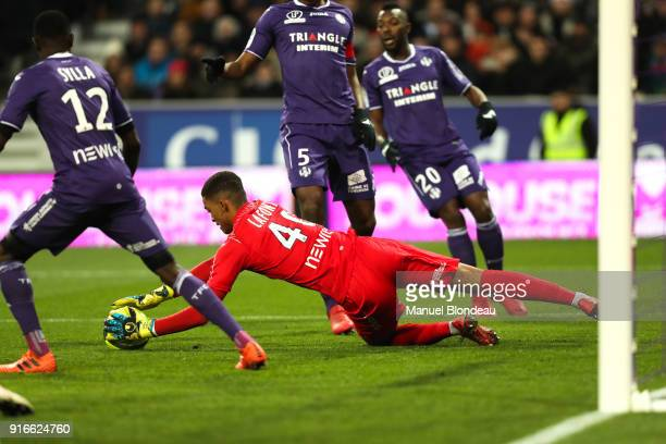 Alban Lafont of Toulouse makes a save during the Ligue 1 match between Toulouse and Paris Saint Germain at Stadium Municipal on February 10 2018 in...