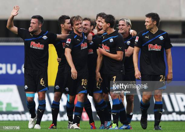 Alban Meha of Paderborn celebrates with his team mates after scoring his team's second goal during the Second Bundesliga match between SC Paderborn...