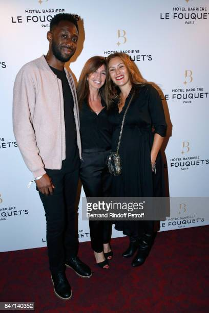Albane Cleret standing between Humorist Thomas N'Gijol and his wife actress Karole Rocher attend the Reopening of the Hotel Barriere Le Fouquet's...