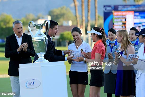 Albane Valenzuela of Switzerland and Hannah O'Sullivan of the United States the two leading amateurs are presented with their trophy after the final...
