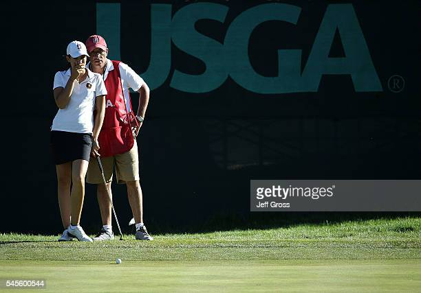 Albane Valenzuela of Switzerland and her caddie discuss a putt on the ninth hole during the second round of the US Women's Open at the CordeValle...