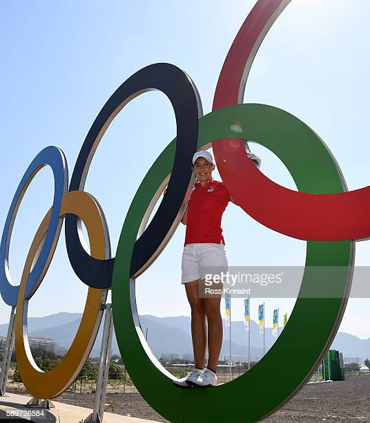 Albane Valenzuela of Switzerland pictured with the Olympic rings during a practice round prior to the Women's Individual Stroke Play golf at the...