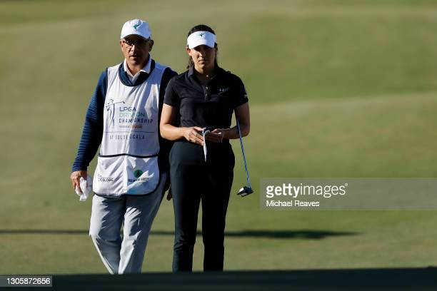 Albane Valenzuela of Switzerland talks with her caddie and father, Alberto Valenzuela, on the 16th hole during the final round of the LPGA Drive On...