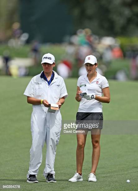 Albane Valenzuela of Switzerland waits to play her second shot on the par 4 first hole with her caddie Alexis Valenzuela during the third round of...