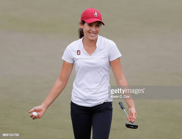 Albane Valenzuela of the Stanford Cardinal reacts after defeating Alyaa Abdulghany of the USC Trojans on the 16th green during day three of the 2017...