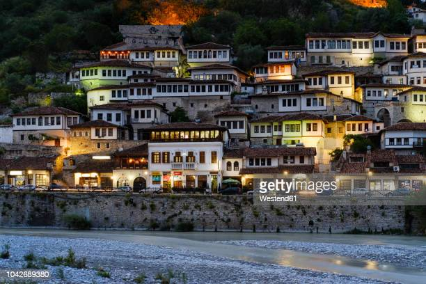 albania, berat county, berat, mangalem, osum river, ottoman houses in the evening - albania stock-fotos und bilder