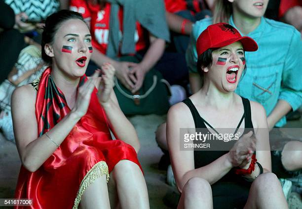 Albania fans react as they sit in the fan zone of Tirana during the Euro 2016 match between Albania and Romania on June 19 2016 / AFP / STRINGER