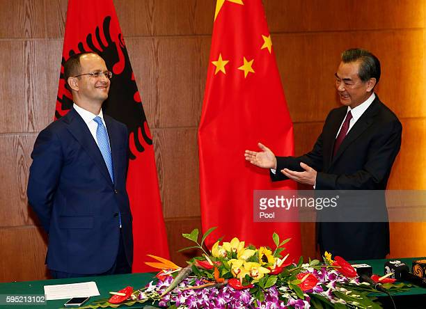 Albania Foreign Minister Ditmir Bushati reacts as Chinese Foreign Minister Wang Yi gestures to him after a meeting at the Foreign Ministry in Beijing...