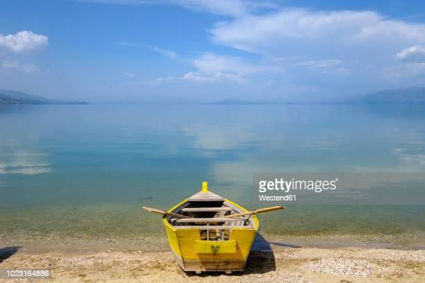 albania, korca, lake ohrid, rowing boat at lakeshore - lake ohrid stock photos and pictures