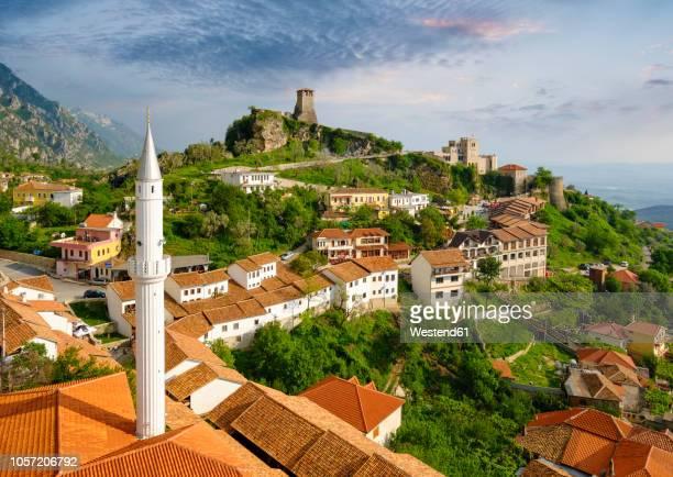 albania, kruje, townscape with bazaar street, bazaar mosque, skanderbeg museum and fortress - albanië stockfoto's en -beelden
