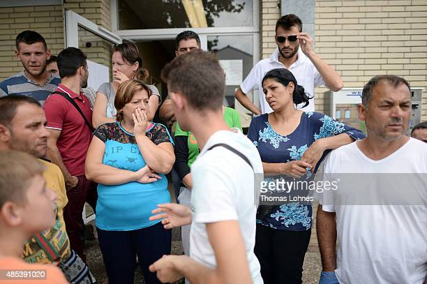 Albania migrants seeking political asylum stand at the registration center on August 27 2015 in Ingelheim Germany German Vice Chancellor and Economy...