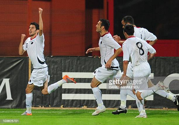 Albania' s Gjergz Muzaka celebrates with team after he scored against Romania during their Euro 2012 qualifying football match in PiatraNeamt city...