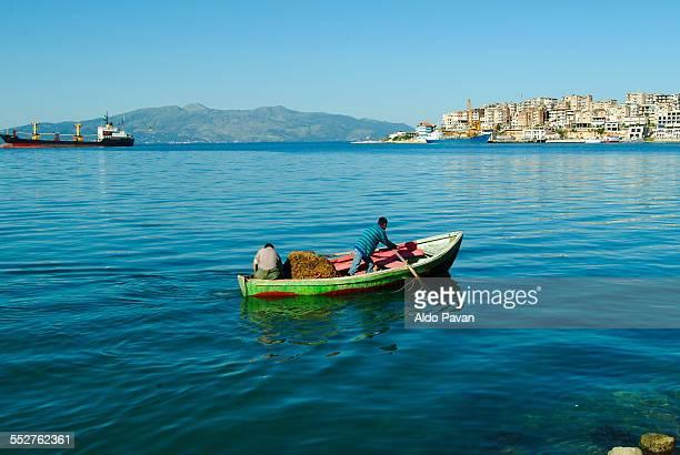 albania, sarande, fisherman - albanië stockfoto's en -beelden
