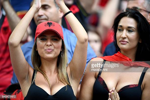 Albania supporter and television personality Rike Roci waits for the start of the Euro 2016 group A football match between France and Albania at the...