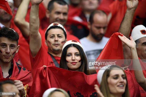 Albania supporters cheer for their team ahead of the Euro 2016 group A football match between Albania and Switzerland at the BollaertDelelis Stadium...
