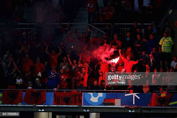 Albania supporters light a flare after their opening goal during the UEFA EURO 2016 Group A match between Romania and Albania at Stade des Lumieres...