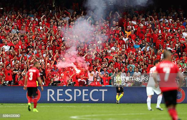 Albania supporters light a flare during the UEFA EURO 2016 Group A match between Albania and Switzerland at Stade BollaertDelelis on June 11 2016 in...