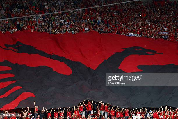 Albania supporters spread a giant flag prior to the UEFA EURO 2016 Group A match between Albania and Switzerland at Stade BollaertDelelis on June 11...