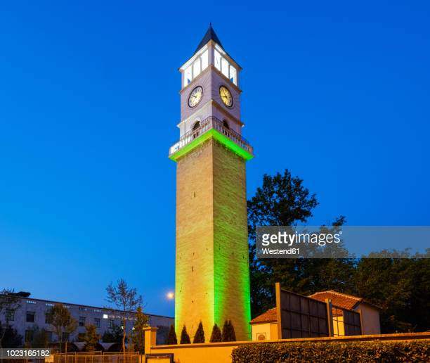 albania, tirana, clocktower of tirana at blue hour - clock tower stock pictures, royalty-free photos & images