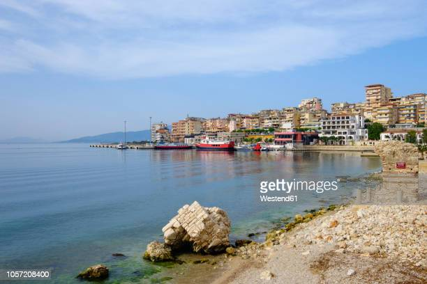 albania, vlore county, saranda, ferry port and former watchtower - albania stock-fotos und bilder