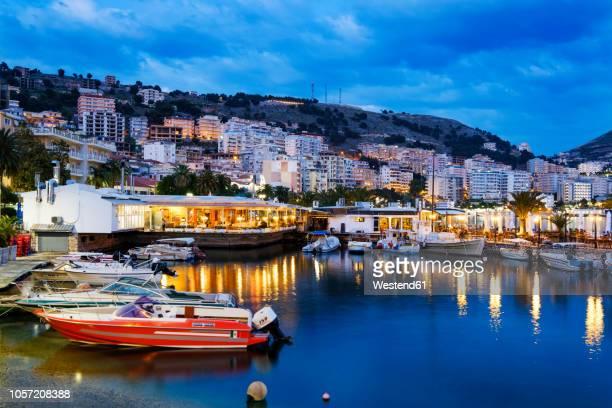 albania, vlore county, saranda, fishing harbour in the evening - albania foto e immagini stock