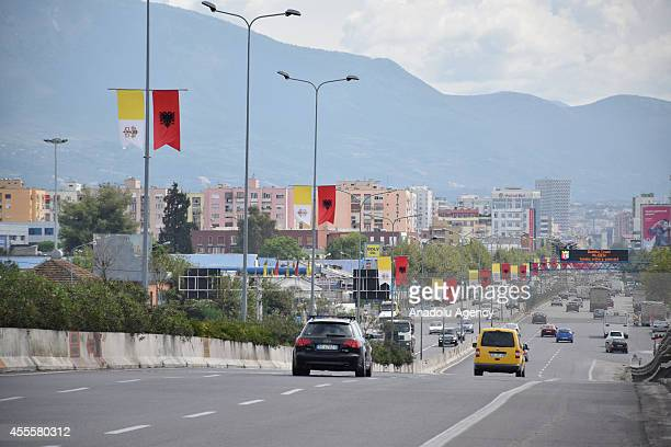 Albanian and Vatican flags hanging on the street lambs in Tirana on September 17 2014 before Pope Francis' Albania visit on September 21
