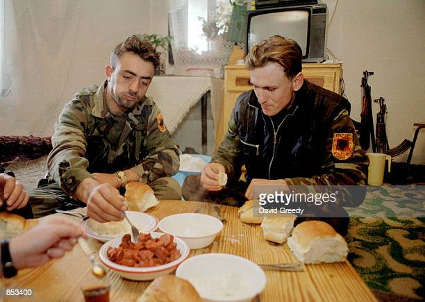 Albanian brothers Metat and Naim eat breakfast before resuming their duties with the ethnic Albanian UCPMB rebels February 23 2001 in Bukovac Serbia...
