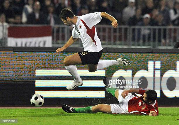 Albanian Cama Lorik fights for the ball with Hungarian Peter Halmosi during their World Cup 2010 qualification match on October 11 2008 at Puskas...