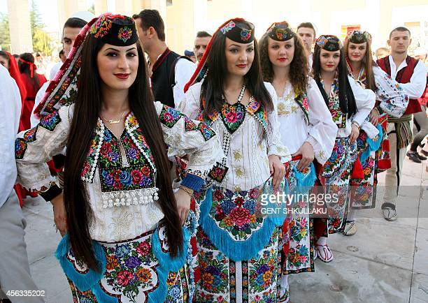 Albanian dancers wearing traditional costumes wait to perform as the nation marks National Cultural Heritage Day and European Heritage Day in the...