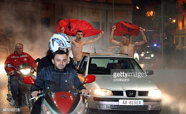 Albanian drive through the streets of Tirana following the abandoned UEFA Euro 2016 qualifying football match between Albania and Serbia that took...