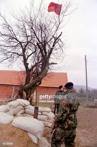 Albanian fighters from the Liberation Army of Presevo Medvedja and Bujanovac stand guard February 14 2001 at the UCPMB regional command post in the...