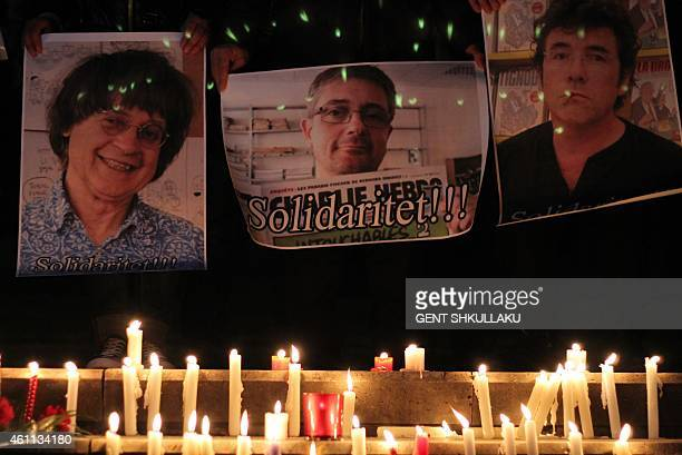 Albanian journalists hold pictures of French satirical weekly Charlie Hebdo's cartoonists Jean Cabut aka Cabu Charb and Tignous during a gathering in...