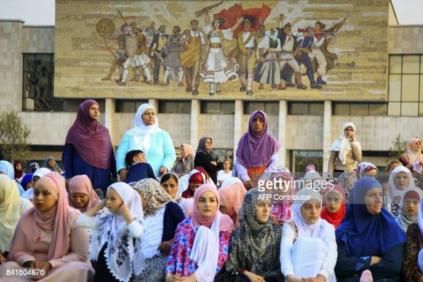 Albanian Muslim women pray in Tirana's Skenderbej square to mark the first day of the Eid alAdha holiday on September 1 2017 Muslims across the world...