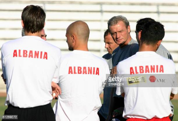 Albanian national team coach, German Hans-Peter Briegel looks at photographers during a training session, in Durres, on the eve of their match...